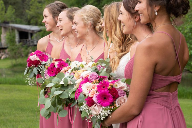 bridal party holding wedding flowers