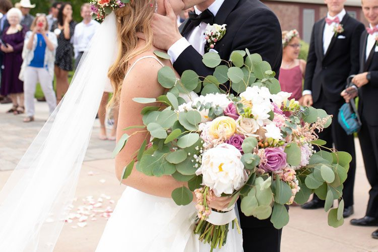 bride and groom holding wedding bouquet