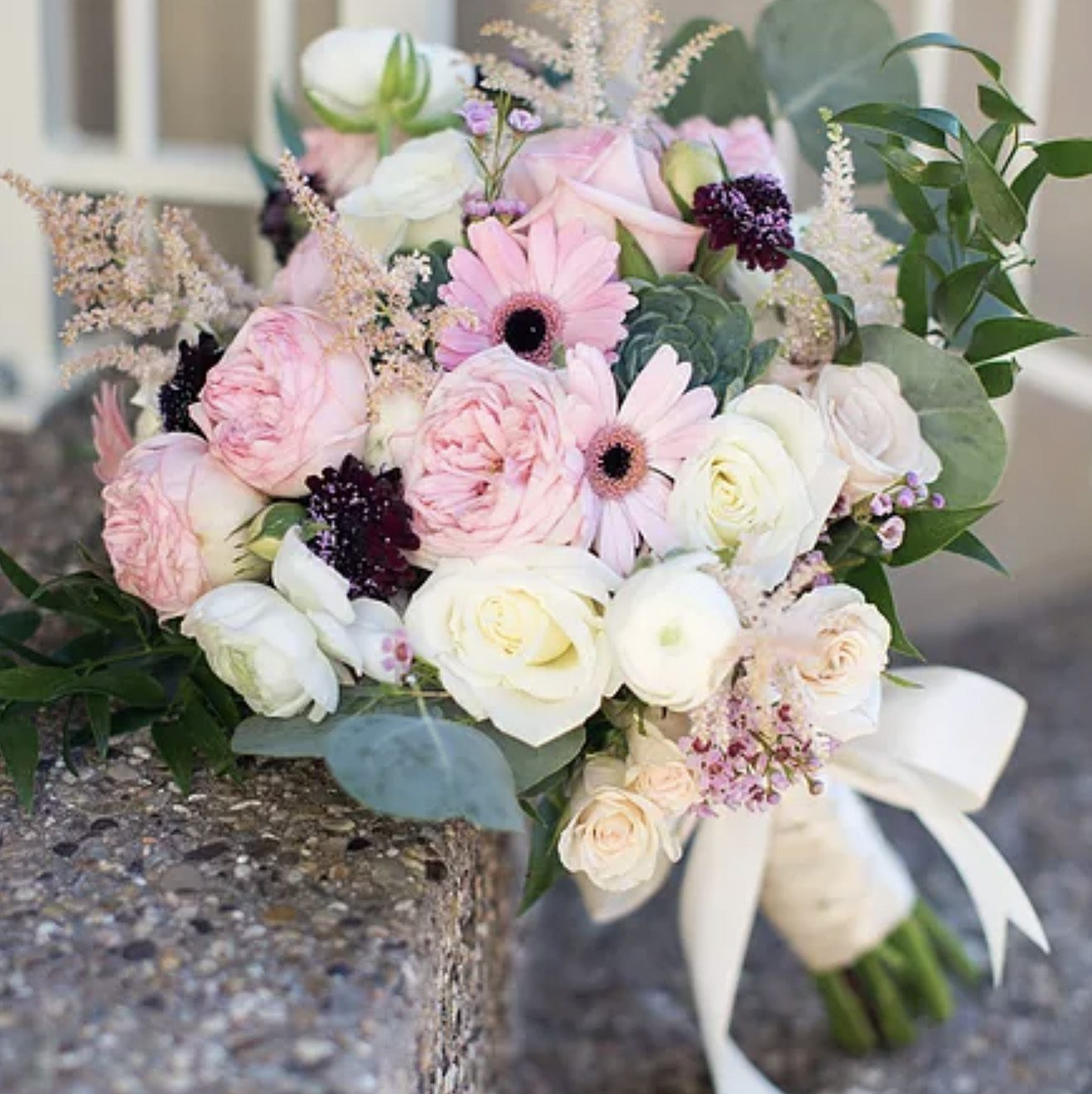 wedding flowers bouquet leaning against stone