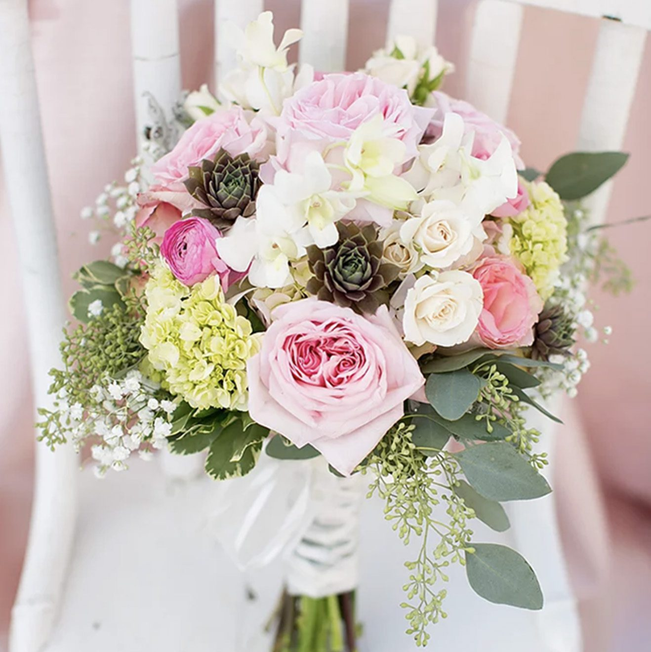 wedding bouquet of bride sitting on chair
